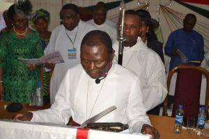 Archbishop Egbunu reading his Bishop's Charge